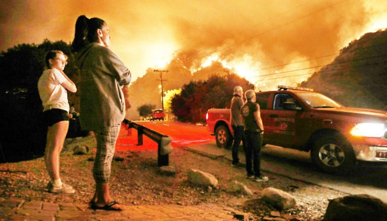 'It'll start getting cooler, just watch': Trump dismisses climate change concerns amid US fires