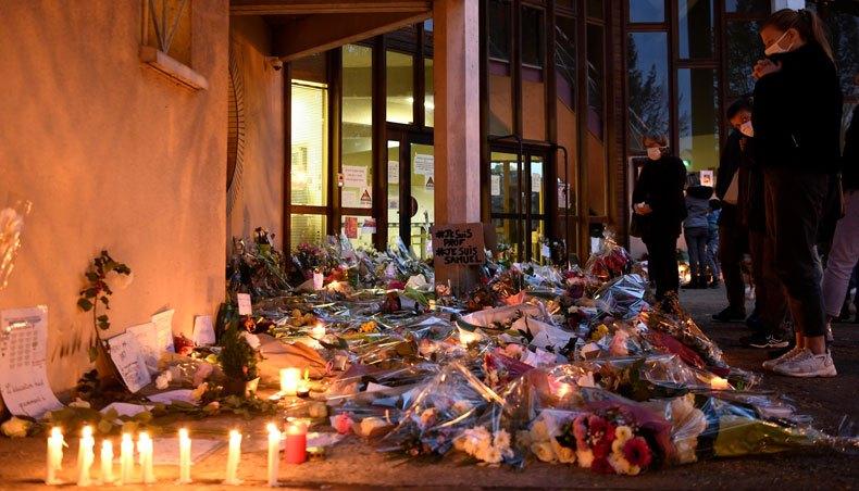 Police arrest nine after teacher beheaded in Paris suburb