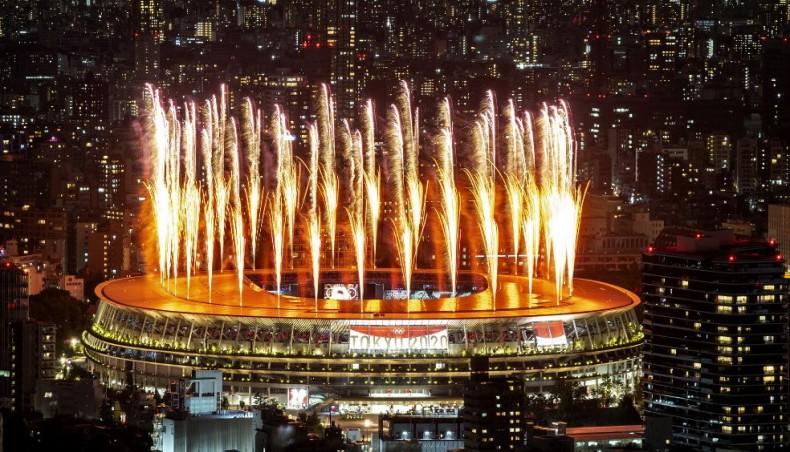 Tokyo Olympics open in low-key ceremony